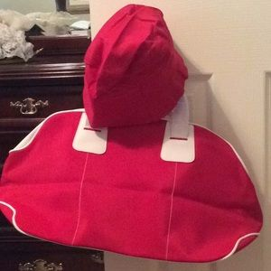 Red and white duffle bag, red hat, Estée Lauder